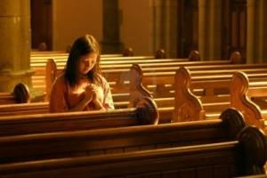 Woman-praying-at-church